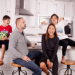Family Happily Sitting in Kitchen